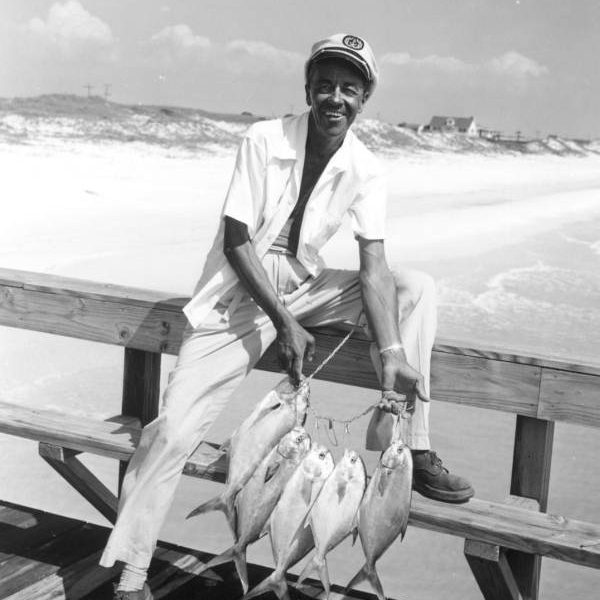 Captain Reddin Brunson displays his catch of fish on the pier at the Destin Rodeo - Destin, Florida1956