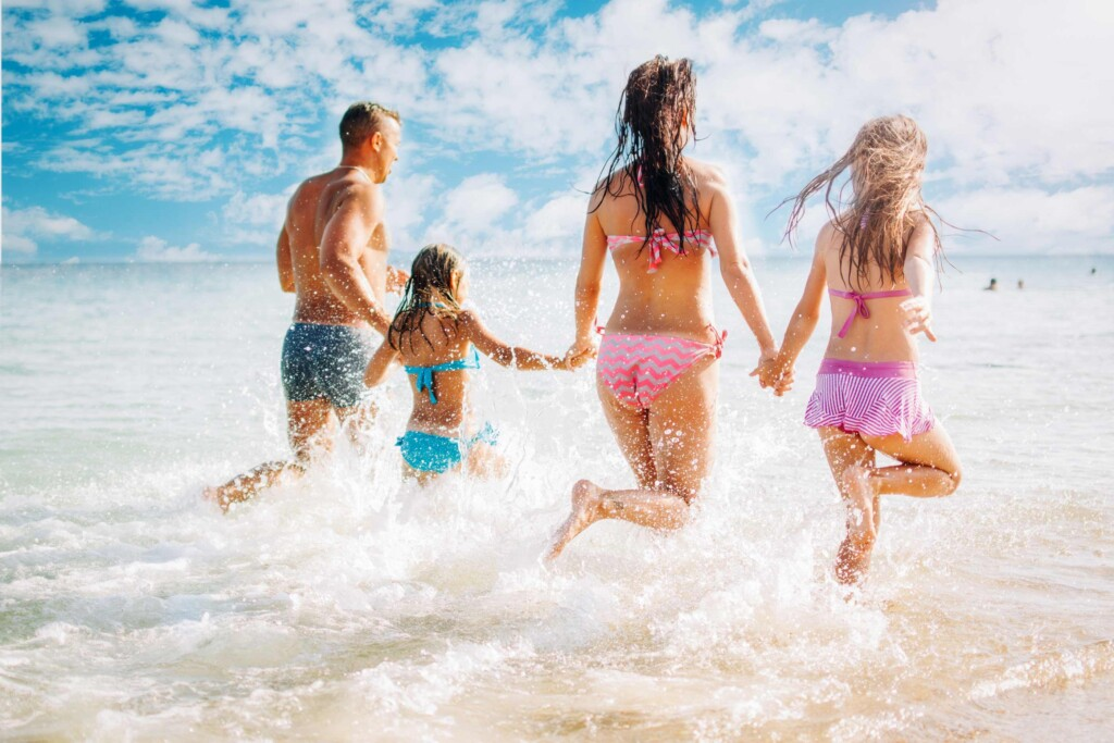 happy vacation rental guests at the beach